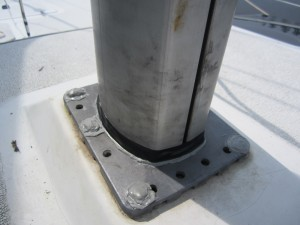 Electrical tape band around butyl tape on mast; butyl tape over bolts
