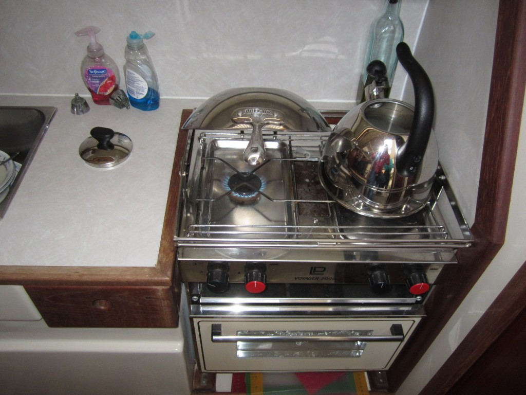 Inverted wok shields the galley headliner from direct propane flame heat